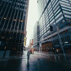 man-walking-on-sidewalk-near-high-rise-buildings-3992446
